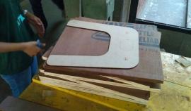 Aishwaraya marking the plywood